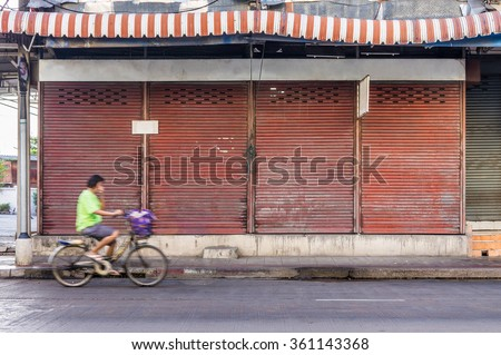 Old closed shop nearby the street. It is traditional Thai shop in Thailand. - stock photo