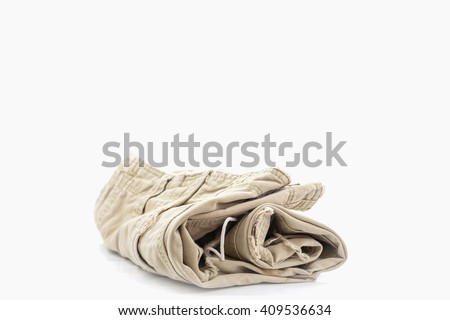 old clothes on white background - stock photo