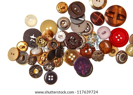 Old clothing buttons on white background - stock photo