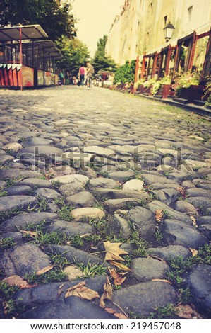 Old cobble stone street in bohemian Belgrade in the autumn - stock photo