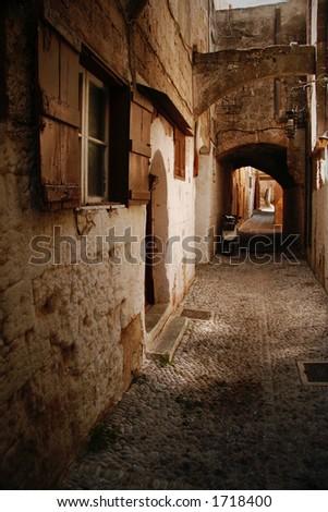 old cobbled mediterranean street in oldtown of rhodes - stock photo