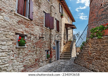 Old cobbled street in Italy - stock photo