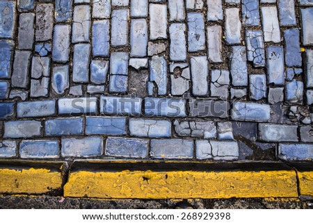 Old Cobblestone street and yellow line from Old San Juan PR - stock photo