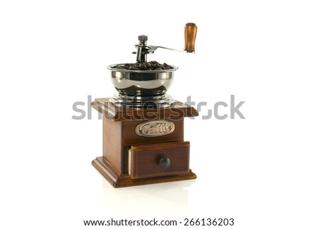 old coffee grinder filled with beans for a good coffee