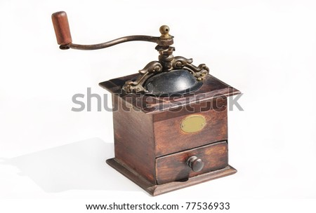 old coffee grinder on white background