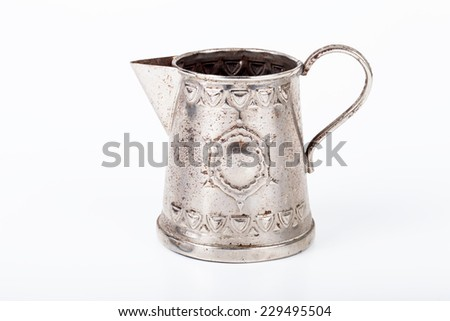 Old coffee pot without cover with spots of rust on a white background - stock photo