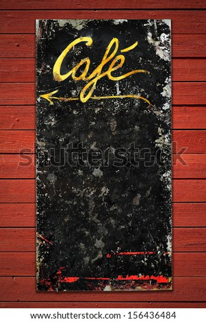 Old coffee sign in weathered metall on a red vintage wall, space for own text - stock photo