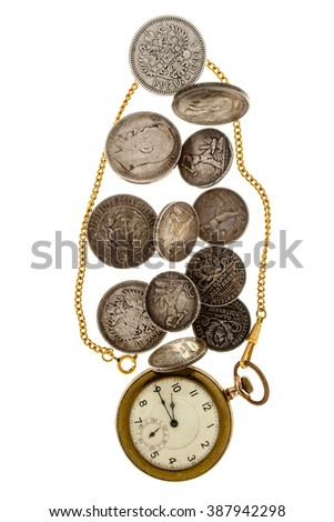 Old coins and pocket watch on a white background.
