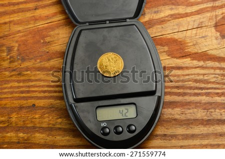 old coins 5 gold rubles Russian Empire 1898, on electronic scales - stock photo