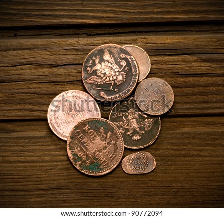 old coins of Russian Empire in the background of old weathered wood - stock photo