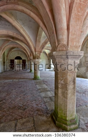 Old colonnaded interior shot in the Abbaye de Fontenay in Burgundy - stock photo