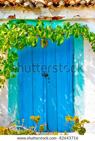 Old colored door in Greek house