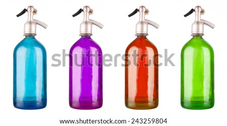 Old colored soda siphons isolated on white - stock photo