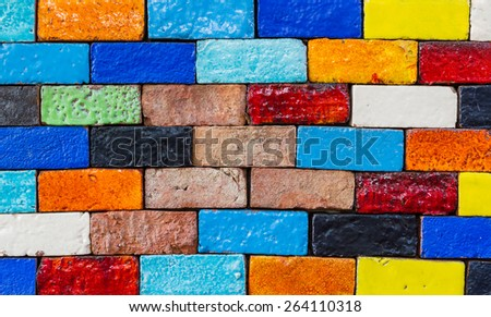 Old colourful brick, wall texture background, stained tiled brickwork horizontal pattern.