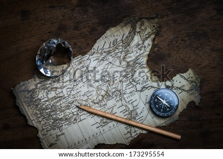 Old compass and vintage map