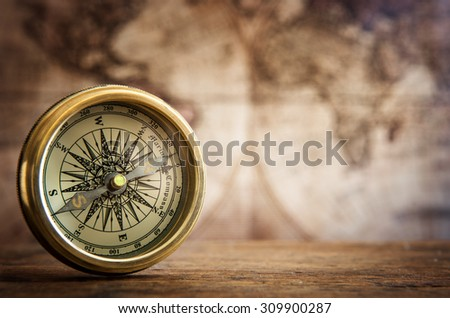 Old compass and vintage map. Retro stale.
