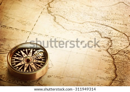 Old compass and vintage map. Retro stale. - stock photo
