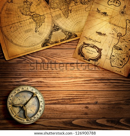 Old compass and vintage maps - stock photo