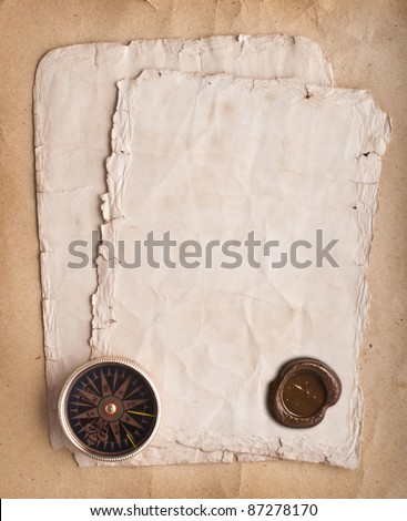 old compass on grunge background - stock photo
