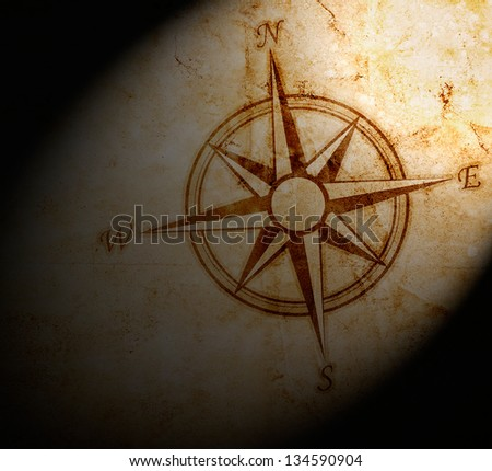 Old compass on paper background - stock photo