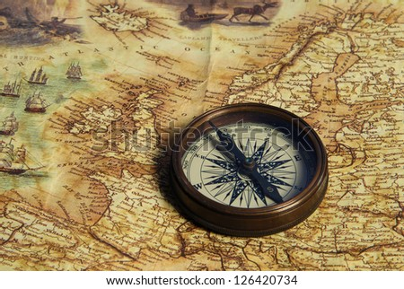 Old compass on the background of brown boards - stock photo