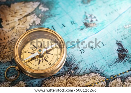 Old compass on vintage map adventure foto de stock libre de old compass on vintage map adventure stories background retro style gumiabroncs Gallery