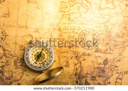 Old compass on vintage map. Retro style. - stock photo