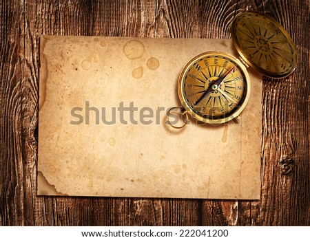 old compass  on vintage paper - stock photo