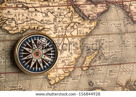 Old compass on vintage retro map 1687  - stock photo