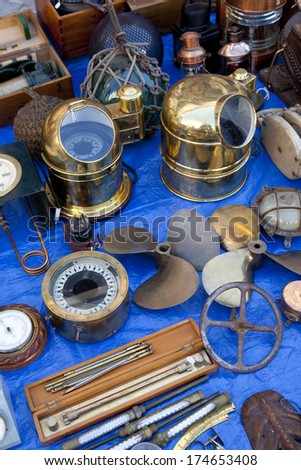 Old Compasses, Propellers and another naval antiques in a street market. Naval Antiques. - stock photo