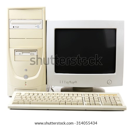 Old computer isolated on white - stock photo