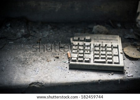 Old computer keyboard in abandoned room - stock photo