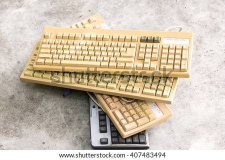 old computer keyboards ready to be recycled - stock photo