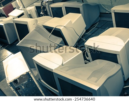 Old computer monitors gathered on the floor - stock photo