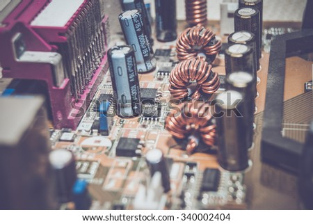 old computer motherboard. tinted photo - stock photo