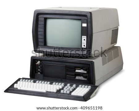 Old computer. The system unit, monitor and keyboard isolated on white background. - stock photo