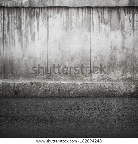 Old concrete wall and asphalt. Abstract industrial interior background texture - stock photo