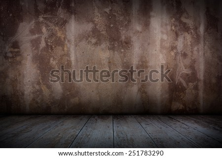 Old concrete wall and wooden floor. - stock photo
