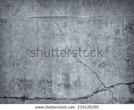 Old concrete wall with cracks - stock photo
