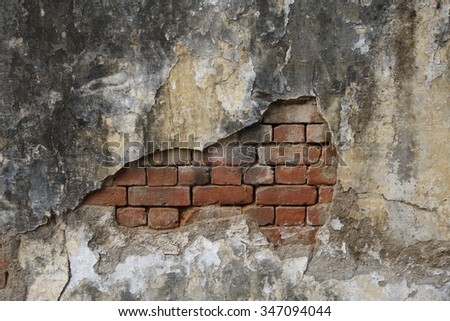 Old concrete wall with exposed brick wall - stock photo