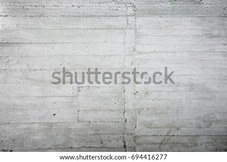 Old concrete wall with visible layers, painted white, fragment