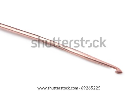 old coppercrochet hook on a white background - stock photo