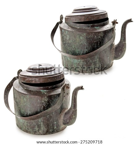 Old copper kettle isolated on the white background - stock photo