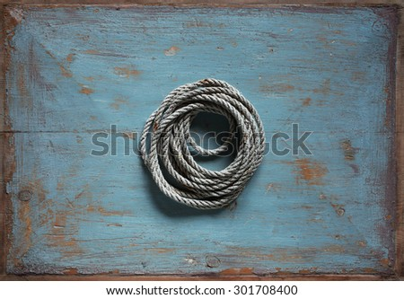 Old cord on vintage blue background