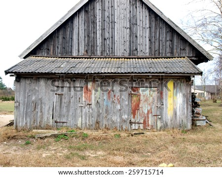 Old country farm barn with firewood shed        - stock photo