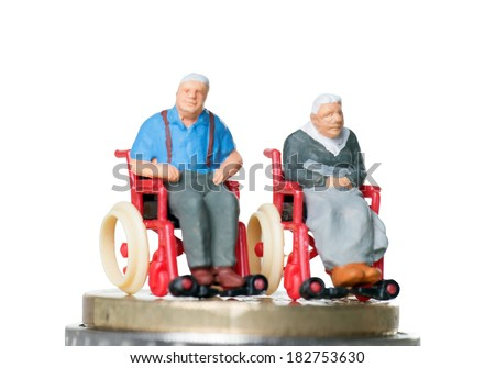 Old couple in a wheelchair with euro money / wheelchair user - stock photo
