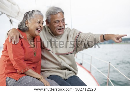 Old couple looking at something - stock photo