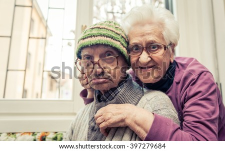 old couple portrait. grandparents posing for a family portrait, Image taken at home as a family memory - stock photo