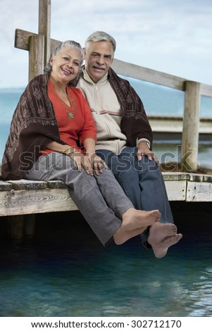 Old couple sitting together - stock photo