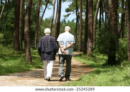 old couple walking - stock photo